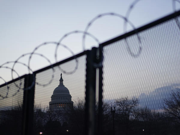 Heightened security imposed after the Jan. 6 riot looms over President Biden's speech to Congress Wednesday, as does the COVID-19 pandemic. About 200 people will attend the event, which ordinarily would have seen 1,600 people.