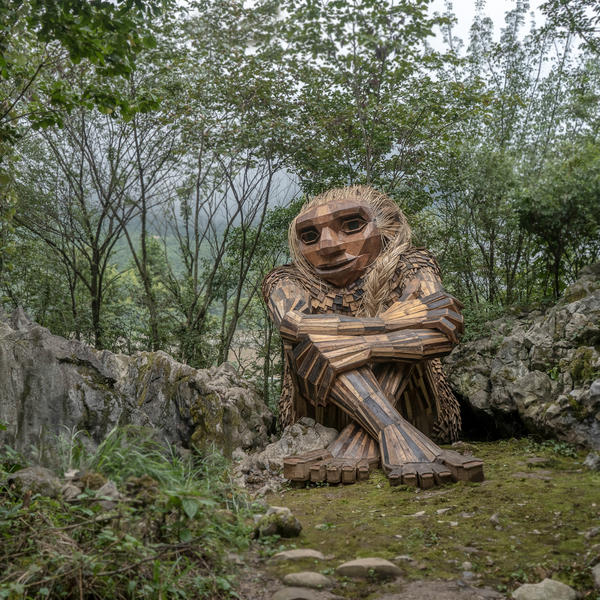 """""""Recycle art activist"""" Thomas Dambo makes gentle giants from scrap wood, old pallets, twigs and debris. Above, the troll Marit in<em> It Sounded Like a Mountain Fell</em> in Wulong, China."""