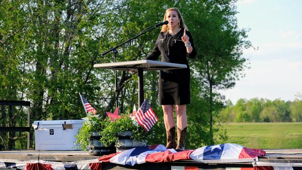 Virginia state Sen. Amanda Chase speaks at a GOP event in King William County. Chase, one of seven Republicans running for governor, has criticized the party-run nominating convention process.