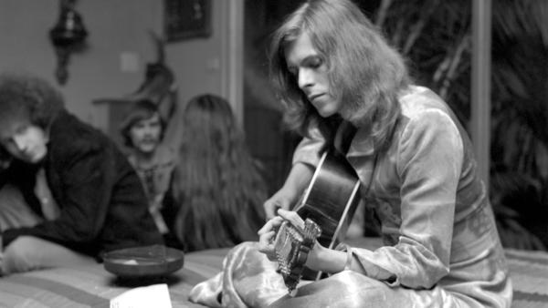 Los Angeles, January 1971: A pre-glam David Bowie jams at a party.