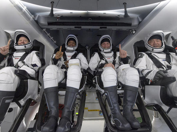 NASA astronauts Shannon Walker (left), Victor Glover, and Mike Hopkins, along with Japan Aerospace Exploration Agency astronaut Soichi Noguchi, are seen inside the SpaceX Crew Dragon Resilience spacecraft onboard the SpaceX GO Navigator recovery ship shortly after landing in the Gulf of Mexico off the coast of Panama City, Fla., on Sunday.