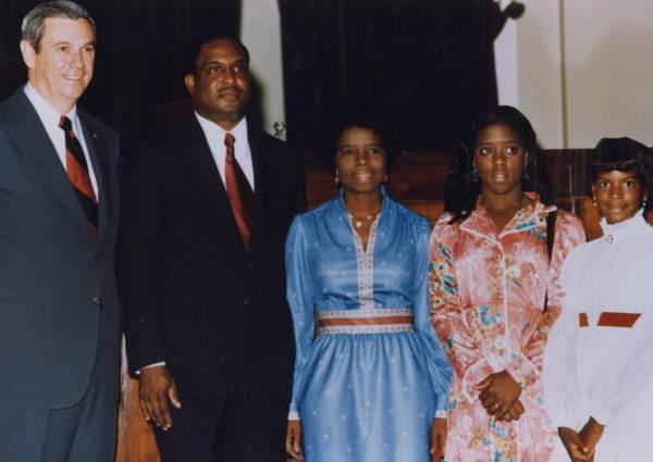 Florida Supreme Court Justice Joseph Hatchett posing with his family and Governor Askew prior to taking the bench - Tallahassee, Florida. L-R: Gov. Askew, Justice Hatchett, Mrs. Joseph Hatchett, Cheryl Hatchett and Brenda Hatchett. (Sept. 2, 1975)