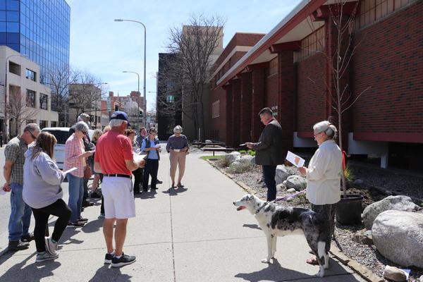 Congregants of Billings First United Methodist Church listen to Reverend Patrick Lewis before planting a tree in honor of those who have died in the past year and to recognize first responders.
