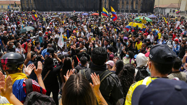 Protesters attend a May Day rally against proposed tax changes in Bogotá on Saturday.