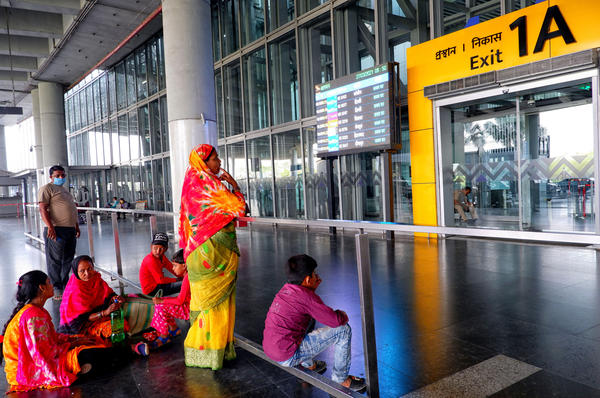 People waiting at an exit gate at the Kolkata Airport Terminal. International air travel to and from India has been restricted as the country battles a catastrophic COVID surge.