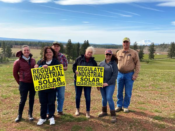 Members of C.E.A.S.E - Citizens Educated About Solar Energy - gather on Amy Hanson's land (center right). Hanson and her husband, Russ, hoped to build their retirement home here, but stopped their plans once they learned their property could be hemmed in.