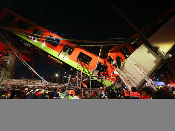 Emergency personnel search for survivors after a raised subway track collapsed Monday night in Mexico City.