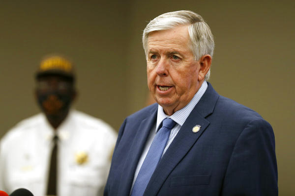 FILE - In this Aug. 6, 2020 file photo, Missouri Republican Gov. Mike Parson speaks during a news conference in St. Louis. Gov. Parson, a former sheriff running for reelection on a law-and-order platform against Nicole Galloway, Missouri's state auditor. (AP Photo/Jeff Roberson, File)