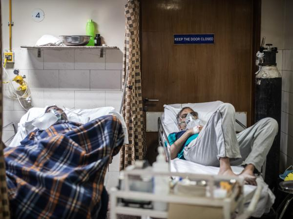 COVID-19 patients in the emergency ward of an unidentified hospital on Monday in New Delhi. Dr. Sumit Ray, a hospital critical care chief in the city, says India's health care system is collapsing.