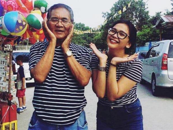 Nardo Samson posing with granddaughter Kiara Bautista, May 2017.