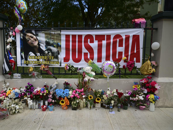"""Flowers, balloons and a poster with the Spanish word for """"justice"""" is part of a growing makeshift memorial for Keishla Rodriguez whose lifeless body was found in a lagoon Saturday, at the entrance of where she lived in San Juan, Puerto Rico."""