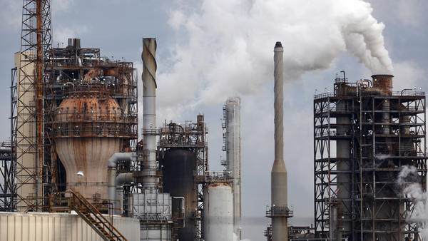 The Royal Dutch Shell refinery is seen in Norco, La. The state is a major petrochemical and oil and gas producer, but Gov. John Bel Edwards has called for a plan to dramatically reduce climate warming emissions.