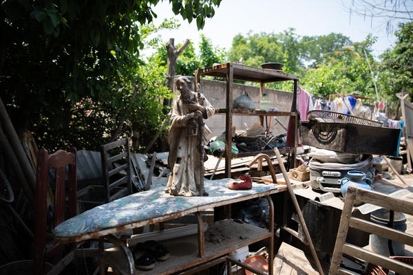 In the weeks after returning after the floods from the hurricanes, the Ramos family collected the muddied detritus of their homestead in their yard.