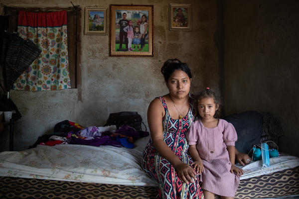Karen Ramos and her daughter, Allison, at their home in La Independencia, in La Lima, Honduras. The family home had been completely submerged after hurricanes Eta and Iota tore through northern Honduras in early November 2020.