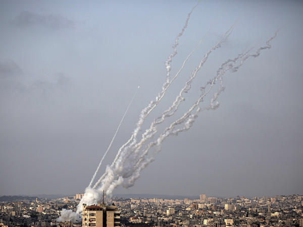 Rockets are launched from Gaza toward Israel on Monday.