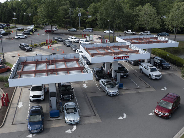 Customers swarm a Costco gas station Tuesday in Richmond, Va., amid fears of a gas shortage. The line at the facility extended around the building.