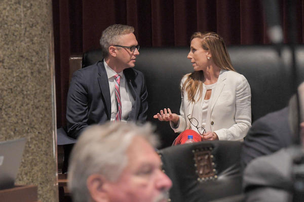 Rep. Nate Tate, R-St. Clair, visits with Sen. Holly Rehder, R-Sikeston, on the side gallery of the House of Representatives. Rehder spent nine years trying to pass a statewide prescription drug monitoring program, and was finally successful in that effort on Tuesday, May 11, 2021.