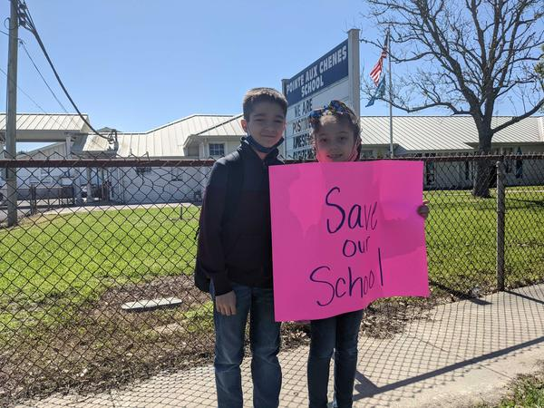 Jackson Dardar (L) says phy ed is his favorite class at Pointe-Aux-Chenes Elementary, and his sister Presley (R) says she loves her school.