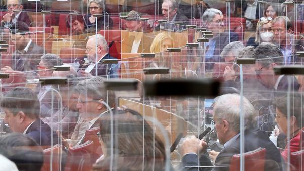 """Calling COVID-19 """"a terrible wake-up call,"""" an independent review panel says national and international leaders failed to respond adequately to the pandemic. Here, members of the Bavarian state Parliament sit among clear panels in Munich in October."""