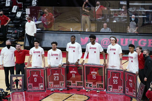 Senior night at Rutgers, where graduating seniors received framed jerseys and applause at the last home game of their careers. Though graduation rates have improved over time, Black basketball players in the NCAA's top division graduate at a rate about 13 percentage points lower than their white teammates.