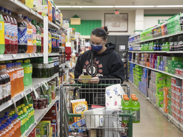 The CDC's new guidelines on face coverings and social distancing are raising questions about grocery store requirements moving forward.