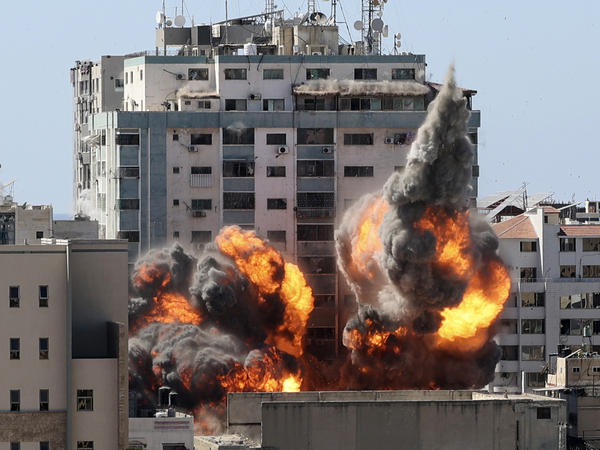 A ball of fire erupts from a building housing various international media, including The Associated Press, after an Israeli airstrike on Saturday in Gaza City. AP staffers and other tenants safely evacuated the building after the Israeli military telephoned a warning that the strike was imminent.
