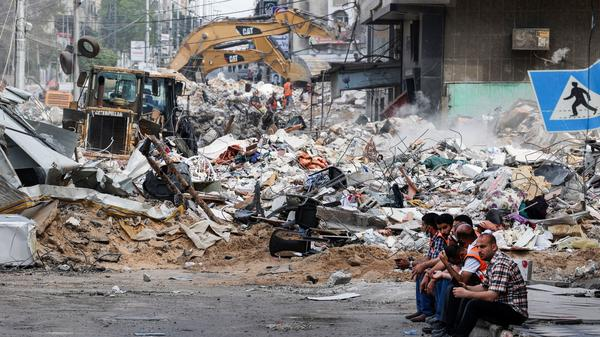 An excavator clears the rubble of a destroyed building in Gaza City on Sunday, following Israeli airstrikes.