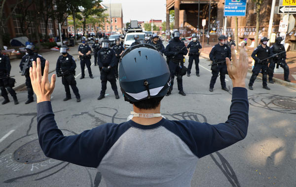 Protesters and Rochester police face off Wednesday morning after officers told them they couldn't block access to City Hall.