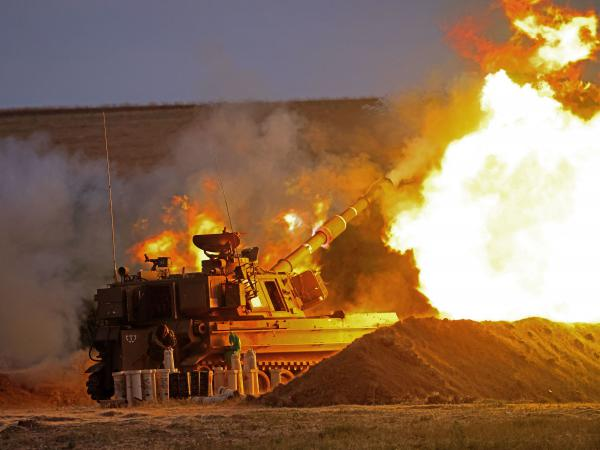 Israeli soldiers fire a howitzer toward the Gaza Strip on Monday. President Biden is among those in Washington encouraging a cease-fire in the conflict between Hamas and Israel.