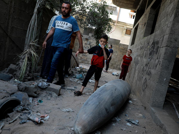 Palestinians look at an unexploded bomb dropped by an Israeli F-16 warplane on Gaza City's Rimal neighbourhood on Tuesday.