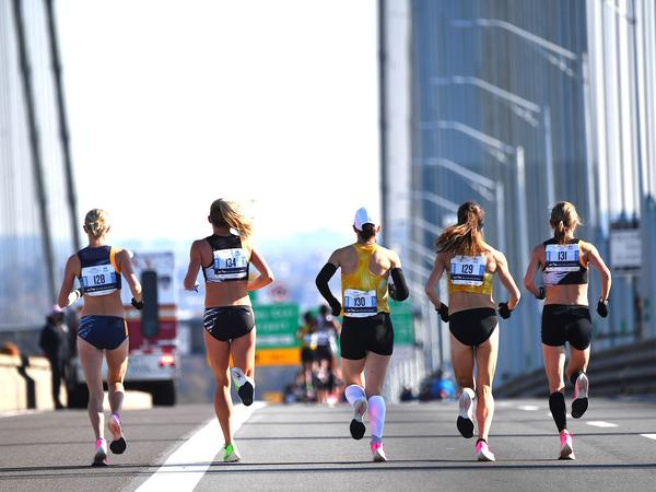 A group of runners compete in the New York City Marathon in 2019. It's one of many big city races to return this year after they were cancelled over pandemic health restrictions in 2020.