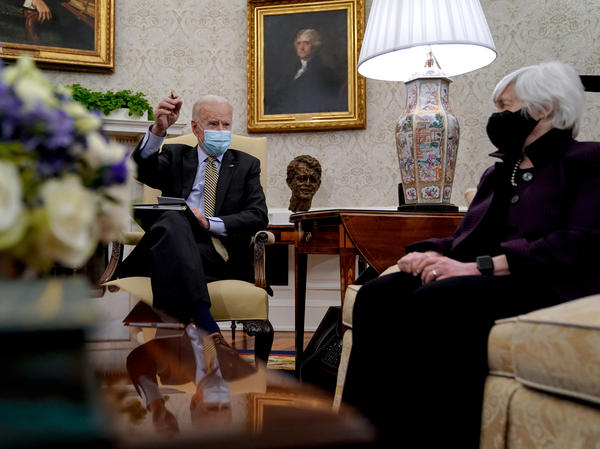 President Biden speaks as Treasury Secretary Janet Yellen listens during the weekly economic briefing in the Oval Office at the White House on April 9. Biden issued an executive order compelling Yellen and other regulators to assess the risk of climate change to America's financial system.