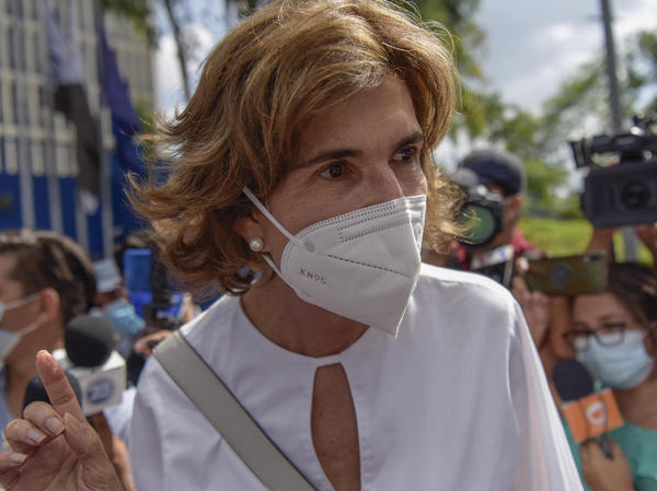 Cristiana Chamorro is seen outside Nicaragua's Ministry of the Interior after being accused of money laundering on Thursday. She has said she'll run against President Daniel Ortega in this year's presidential election.