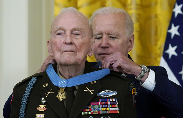 President Biden presents the Medal of Honor to retired U.S. Army Col. Ralph Puckett in the East Room of the White House on Friday.