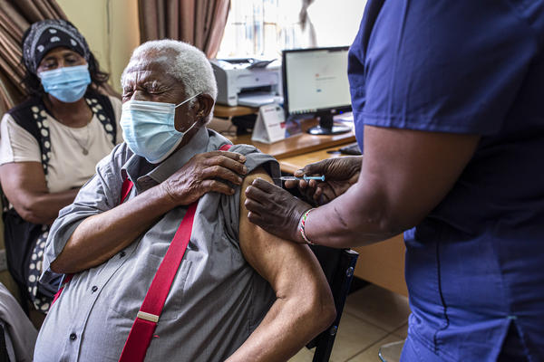 An older person receives their first dose of the AstraZeneca vaccine in Thika, Kenya. The vaccine's manufacturer, Serum Institute of India, announced this week that it will freeze all exports of the vaccine through the end of this year — leaving 20 million people in Africa without a source for their second dose.
