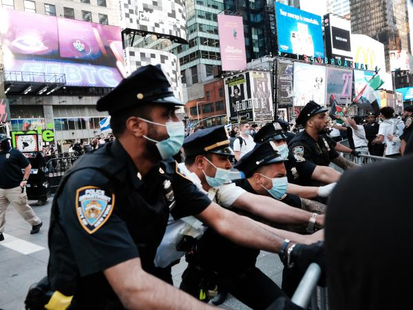 Pro-Palestinian protesters face off with Israel supporters and police last week in Times Square in New York City.