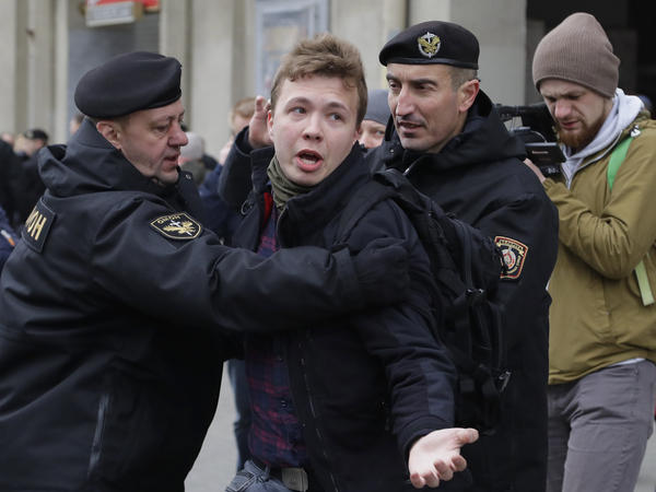 Belarusian police detain journalist Roman Protasevich (center) in Minsk, Belarus, on March 26, 2017. On Sunday, Protasevich was arrested after his international flight was diverted to Belarus.