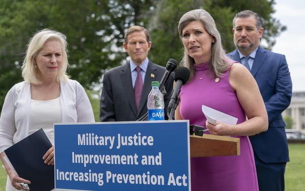 For years, New York Democratic Sen. Kirsten Gillibrand (left) has sought approval of her bill to reform the military's criminal justice system. This year, Gillibrand joined forces with Iowa Republican Sen. Joni Ernst, seen here, a sexual assault survivor herself before she became a combat company commander.
