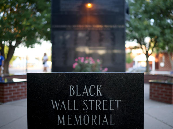The Black Wall Street Memorial last year in Tulsa, Okla. President Biden visited Tulsa on Tuesday for the 100th anniversary of an attack that left as many as 300 people dead.