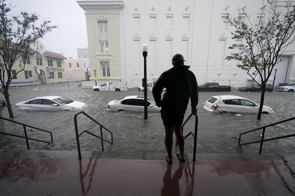 FILE - In this Sept. 16, 2020, file photo, floodwaters move on the street, in Pensacola, Fla. Hurricane Sally made landfall near Gulf Shores, Alabama, as a Category 2 storm, pushing a surge of ocean water onto the coast and dumping torrential rain from the Florida Panhandle to Mississippi and well inland.