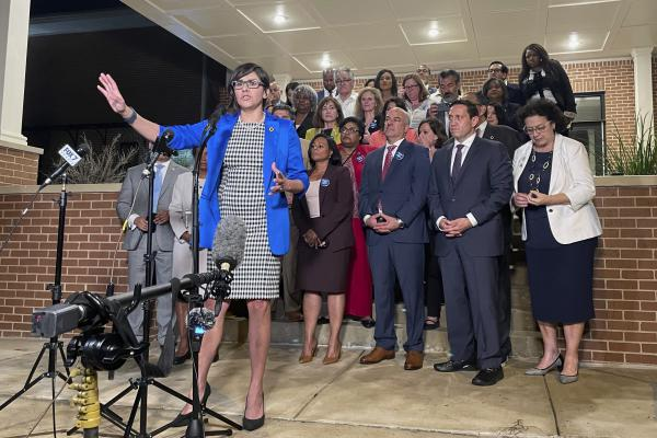 Texas state Rep. Jessica González speaks during a news conference early Monday in Austin after House Democrats pulled off a dramatic, last-ditch walkout in the state Legislature and blocked one of the most restrictive voting bills in the U.S. from passing.