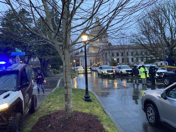 A State Patrol checkpoint greeted arriving state lawmakers at the Washington Capitol on the first day of the legislative session in January. The unprecedented security followed the January 6 attack on the U.S. Capitol.