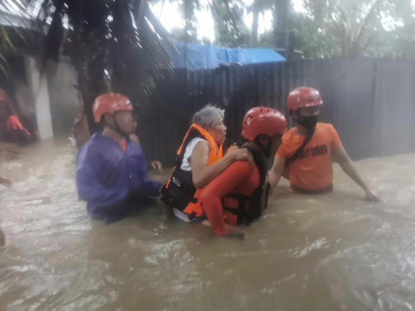 Rescuers take residents to safer ground as floods caused by Tropical Storm Dante hit Maasin City in Southern Leyte province, central Philippines. The tropical storm has left at least a few people dead and displaced hundreds of people in the southern and central Philippines.