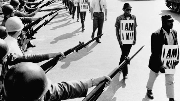 Civil rights activists are blocked by National Guard members brandishing bayonets while trying to stage a protest on Beale Street in Memphis, Tenn., in 1968.