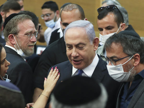 Israeli Prime Minister Benjamin Netanyahu looks on after a special session of the Knesset, Israel's parliament, elected a new state president on Wednesday.