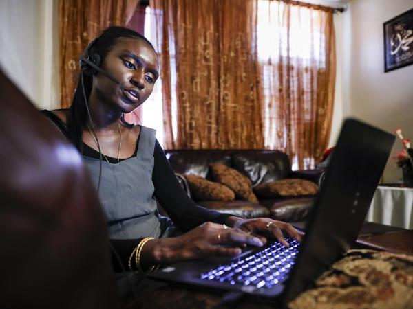 Maryama Diaw, a contact tracer in New York City, worked remotely from her home last year. Coronavirus contact tracing programs across the U.S. are starting to scale back, according to NPR's latest survey.