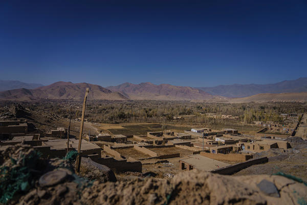 """A view of what the locals call the """"green zone,"""" an area Afghan National Police say is controlled by the Taliban, as seen from a police outpost along the Kabul-Kandahar highway, outside Maidan Shahr, Afghanistan, on Nov. 7, 2020."""