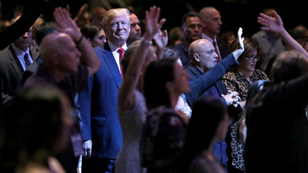 Donald Trump attends a worship service in Las Vegas when he was a presidential candidate in 2016. Trump won over many white conservative Christians by wrapping their traditional priorities in with his own particular cultural fixations.