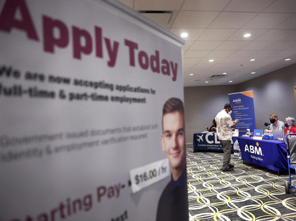 Recruiters looking to fill positions at O'Hare International Airport meet with candidates during a job fair at the Chicago airport on May 19. Hiring was expected to have picked up last month, providing a shot of relief to an economy in need of workers as businesses start to reopen again.