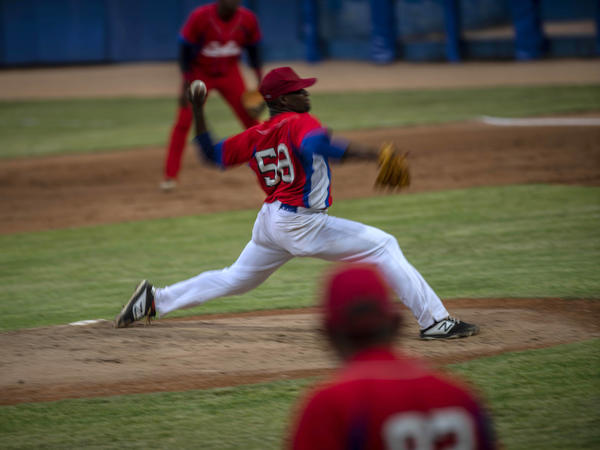Cuba's pitcher Yoanni Yera Montalvo throws the ball during a training session at the Estadio Latinoamericano in Havana last month. Cuba's losses this week in Florida to Venezuela and Canada in Olympic baseball qualifying play means the team will not compete in the Summer Games.